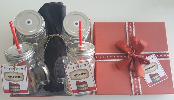 DIY gift box with glass mugs and apple cider